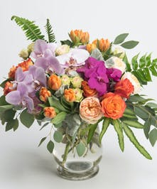 luxury spring bouquet of orchids, garden roses and tulips