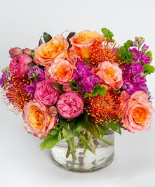 orange protea and hot pink garden roses fall flower arrangement