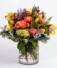 bright and bold winter flower arrangement of orange roses and yellow tulips