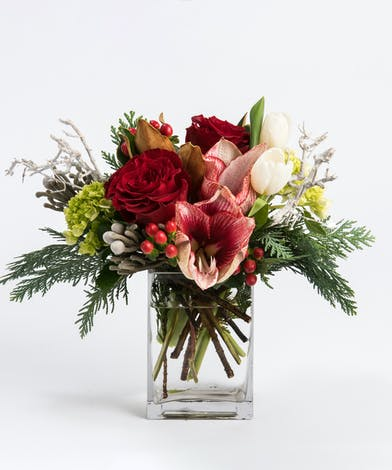 amaryllis and red roses in a cylinder vase