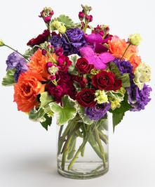 vibrant orange, blue and purple flower arrangement