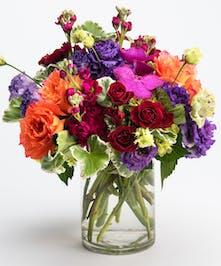 vibrant orange, blue and purple flower arrangement