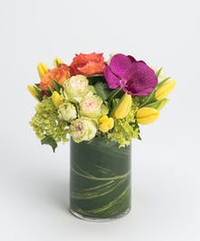 spring arrangement of tulips, orchids and roses