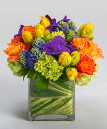 Deep oranges, blues, purples, and greens come together in our signature leaf-lined cube vase