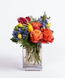 yellow tulips, orange roses and blue hyacinth arrangement