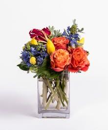 yellow tulips, orange roses and blue hyacinth arrangement