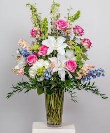 pastel funeral flower arrangement