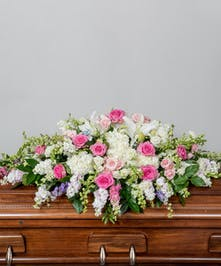 full funeral cakset spray of soft pastel pink, lavender and white blooms