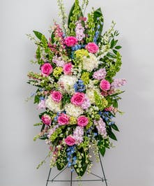 pastel toned standing easel spray funeral arrangement