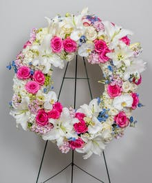 pastel toned floral funeral wreath