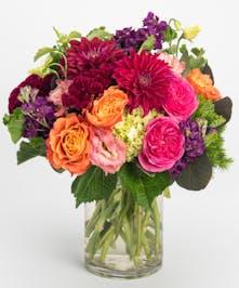 burgundy dahlia, pink roses and purple lisianthus arrangement