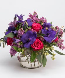 hot pink roses, lilac, and purple orchids