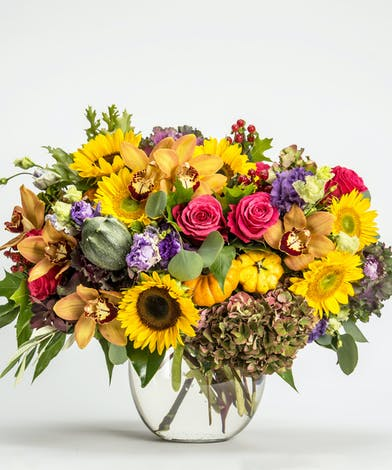luxury arrangement of fall flowers with accents of mini pumpkins and gourds