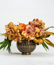 luxury arrangement of bronze cymbidium and coral vanda orchids