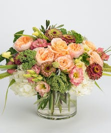 peach roses, pink lisianthus and mauve zinnias arrangement