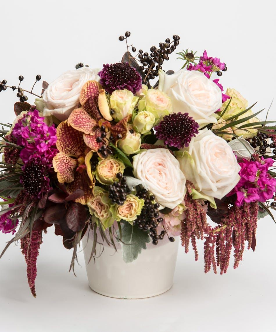 arrangement of crimson, burgundy, and ivory tones