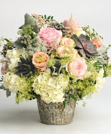peach, pink and white luxury flower arrangement accented with succulents