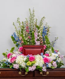 memorial wreath of all soft pink, white, and lavender flowers