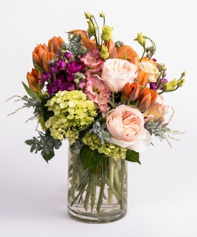 orange tulips, fuschia stock, and pink garden roses flower arrangement
