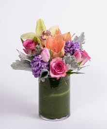 peach amaryllis, pink tulips and lavender stock flower arrangement
