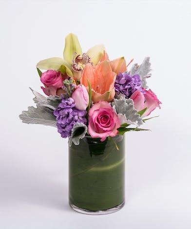 peach amaryllis, pink tulips and lavender stock flower arrangement