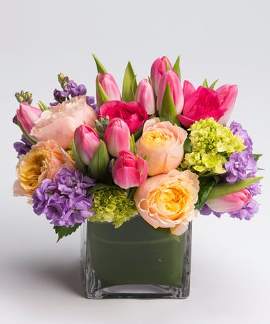 pastel tulips, roses, and stock in a cube vase
