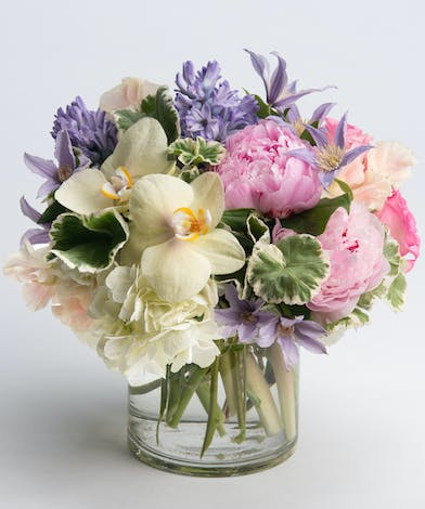 pastel peony, orchids, and clematis arrangement