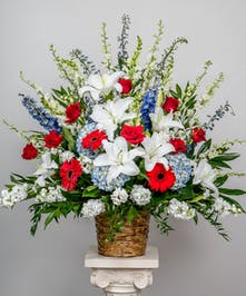 red, white and blue funeral basket arrangement