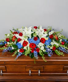 red, white and blue funeral cakset spray