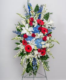 red, white and blue standing funeral spray