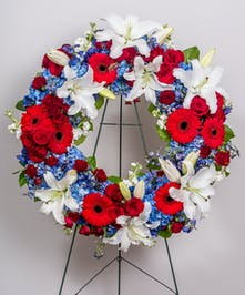 patriotic funeral wreath of all red, white and blue flowers