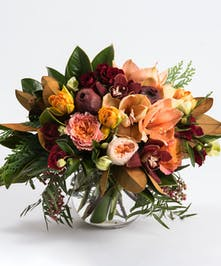 Peach amaryllis, red cymbidiums and winter greens