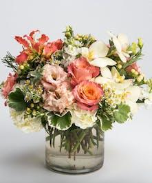 peach roses, orange gloriosa lilies and pink lisianthus