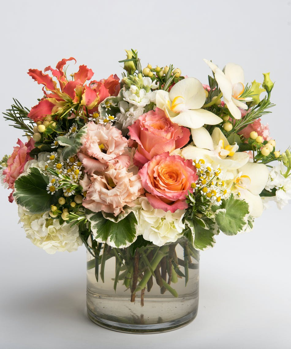 Apricot blush spring flowers philadelphia florist robertsons peach roses orange gloriosa lilies and pink lisianthus mightylinksfo