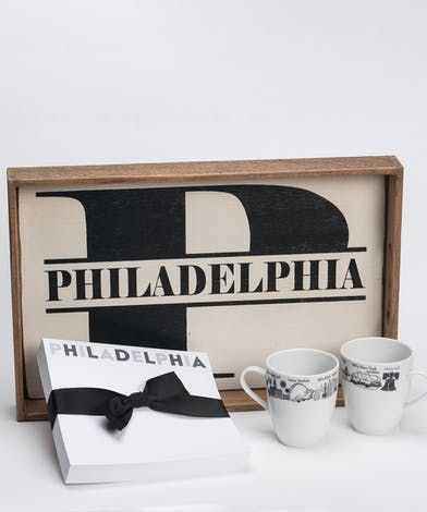 gift set of serving tray, notepad, and 2 mugs with Philadelphia designs