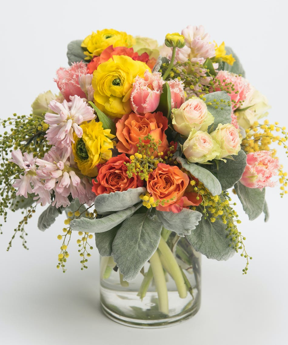 pink hyacinth, yellow ranunculus and orange roses spring arrangement