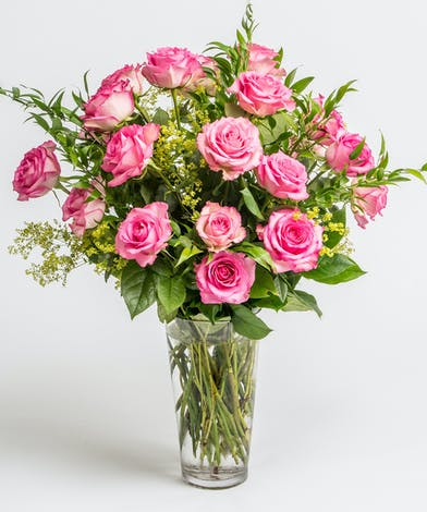 Pink roses with simple sreens in glass vase