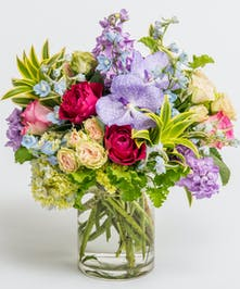 jewel toned blooms with roses and orchids