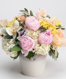 pink peony, white hydrangea, and yellow orchid arrangement