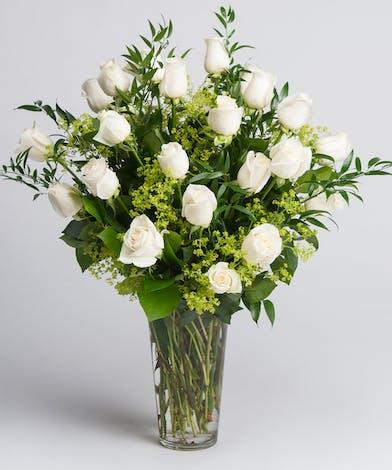 One dozen long stem white roses with premium greens