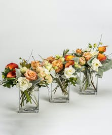 thanksgiving centerpiece of mango callas and peach roses