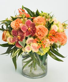 autumn design of orchids, gloriosa lilies and roses
