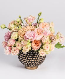 peach garden roses and pink frilled tulips in a gold container