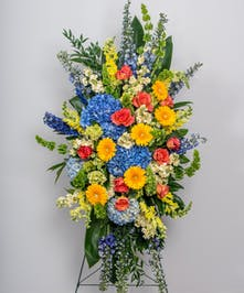 bright and colorful standing funeral spray flower arrangement