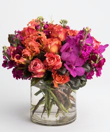 orange roses, purple orchids and hot pink stock