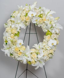 funeral wreath of all whites, creams and greens