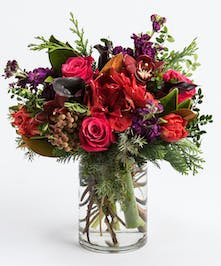 red amaryllis, roses and hydrangea accented with pink anemone