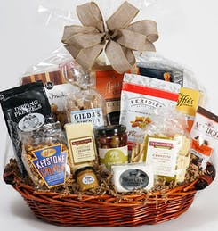A wide variety of individually-packaged snacks in a round gift basket